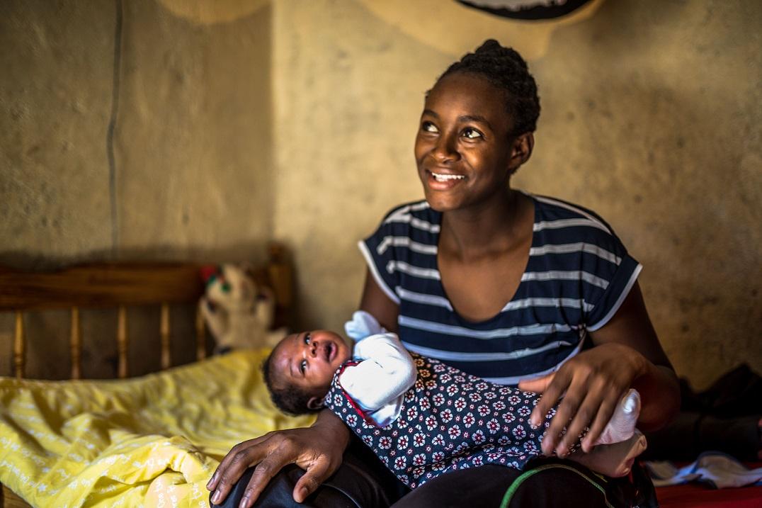 Lilian Mokobi, 24, with her baby in Kibera, Nairobi