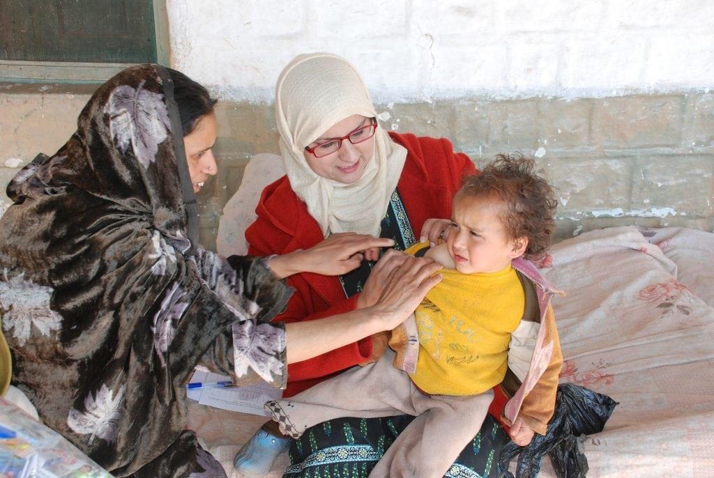 Zwei Frauen mit einem Kind